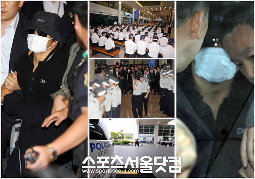 Kim wearing a face mask is arrested by Korean police at the airport
